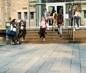 students enterin and exiting an educational institution